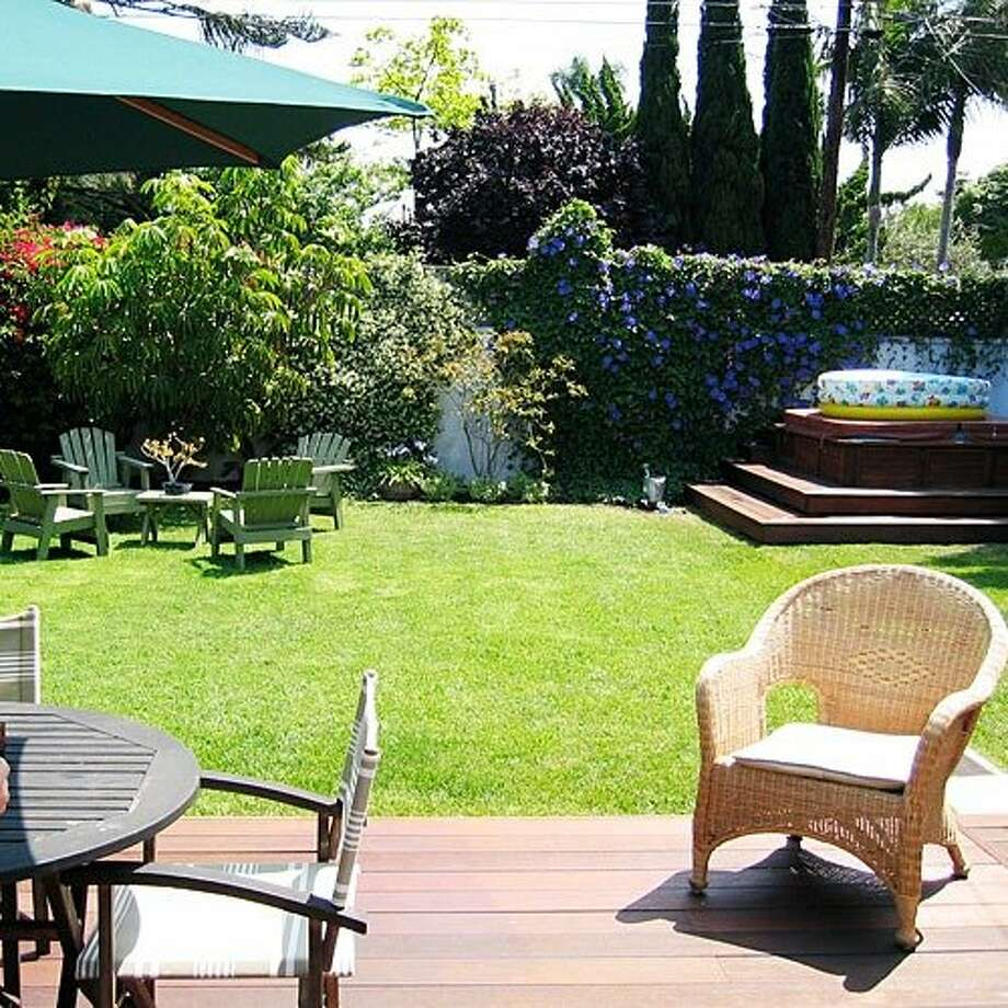 "A plain, old yard  For Darren and Sheila Burris, life's sweetest moments unfold in their backyard over dinners with their children, Sierra, 13, and Reef, 5. That wasn't always the case; before the remodel, ""there was nothing to go out to,"" says Darren. ""The yard was spacious but plain, without much personality.""