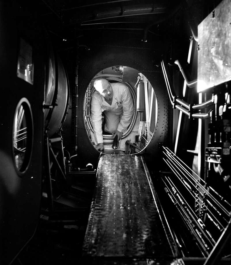 A man crawls through a tight area in the Yankee Clipper.  Photo: Herbert Gehr, Time & Life Pictures/Getty Image / Herbert Gehr
