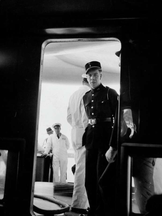 An Azores policeman looks into the hold of Pan Am Clipper. Photo: Bernard Hoffman, Time & Life Pictures/Getty Image / Time Life Pictures