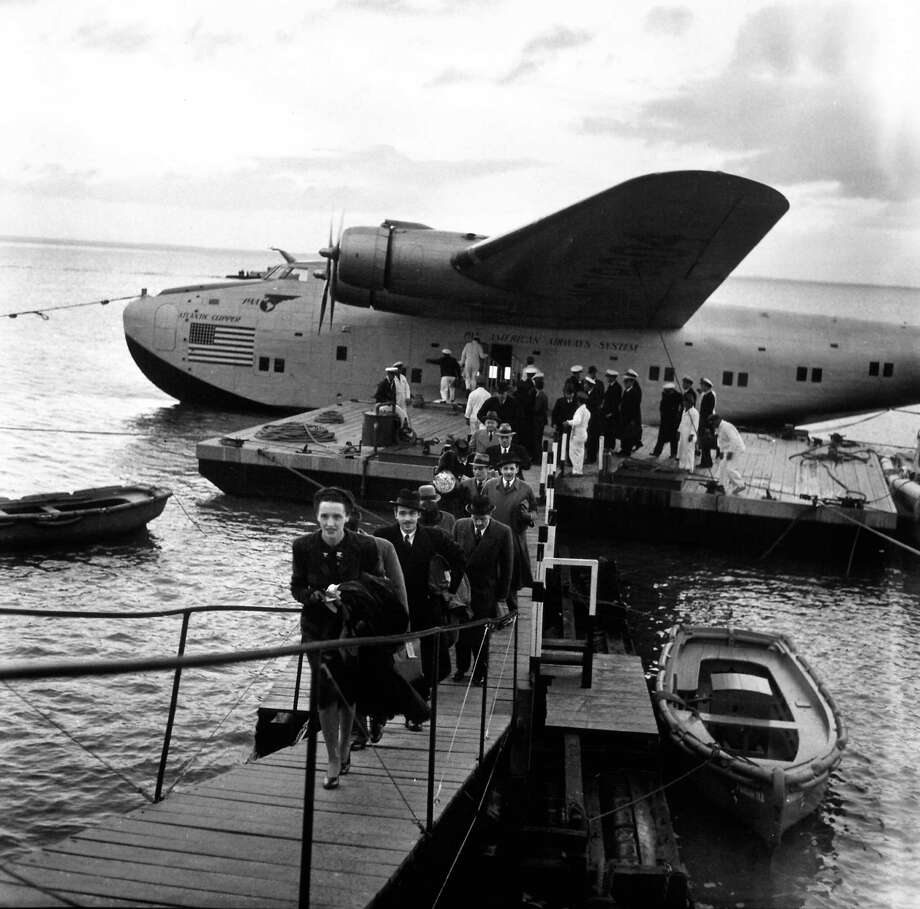 Pan American Clipper passengers disembark at a dock on the Tagus River, in Spain, after a 23-hour flight from New York. Photo: Bernard Hoffman, Time & Life Pictures/Getty Image / Time Life Pictures