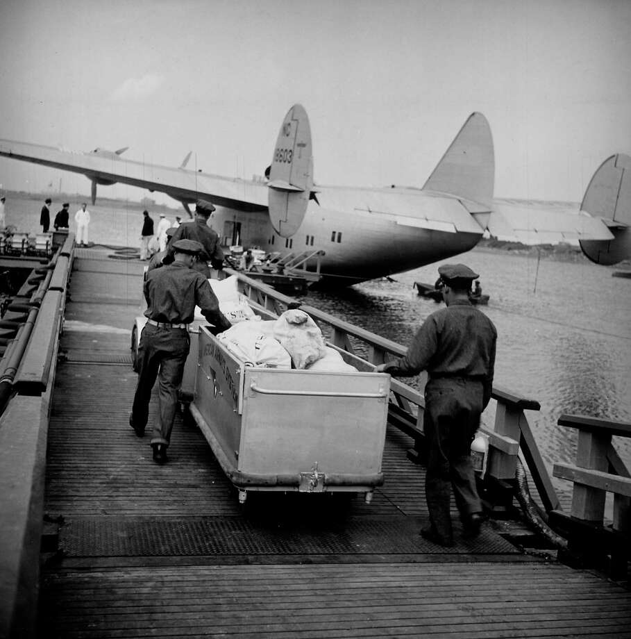 Mail bags are hauled to a transatlantic Pan Am Clipper. Photo: Bernard Hoffman, Time & Life Pictures/Getty Image / Time Life Pictures