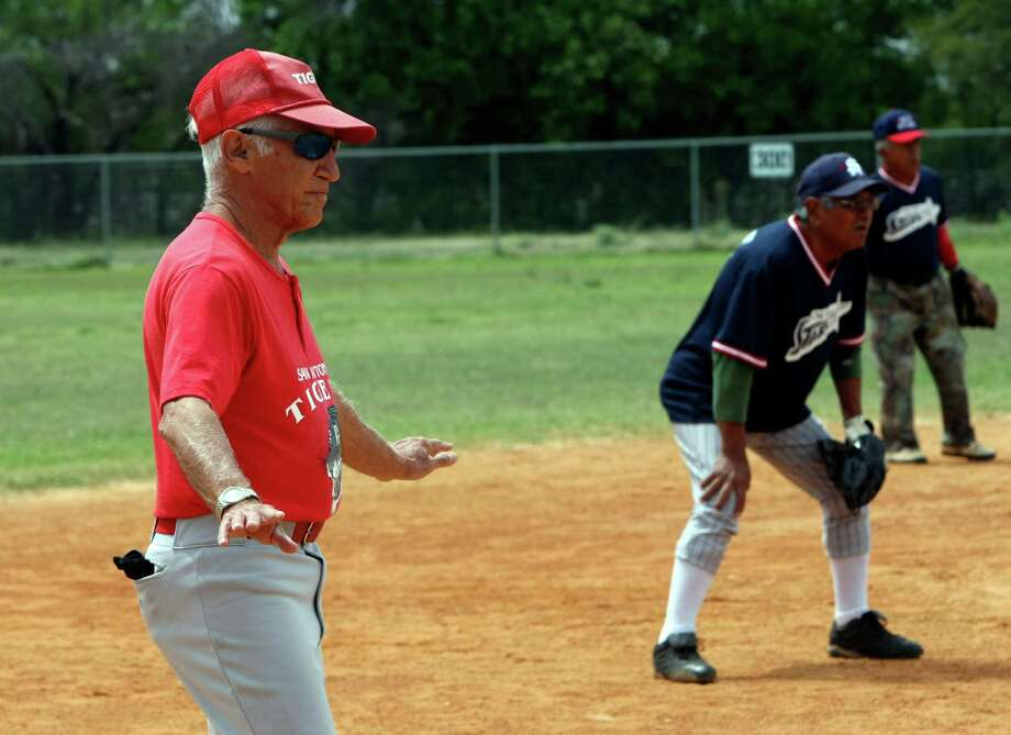 Bill Altman, 82, will be playing with his softball team in the Texas Senior Games. Altman has been named a Personal Best Award recipient by the National Senior Games Association. He founded the San Antonio Senior Softball league in 1987 and competes in tennis and track and field events. He and his senior softball team will be competing in the 2013 National Senior Games in Cleveland in July. Altman is a player and manager. Photo: Helen L. Montoya, San Antonio Express-News / ©2013 San Antonio Express-News