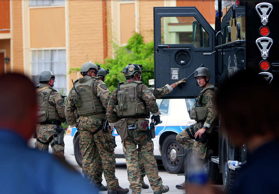 The Houston SWAT team reacts during a situation in the 9300 block of Clay Rd., Thursday, June 6, 2013, in Houston. Photo: Cody Duty, Houston Chronicle / © 2013 Houston Chronicle