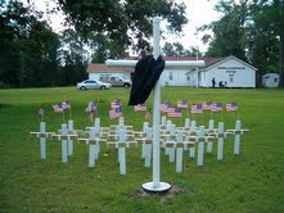 Veterans of Foreign War Post 1514 and the American Legion Post 72 members gathered May 27 to pay homage to fallen heroes. Photo: Handout