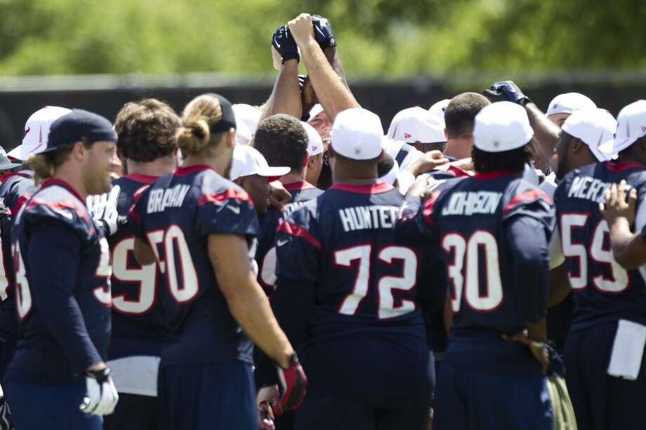 Texans players gather together at the beginning of Thursday's OTA at the Methodist Training Center .