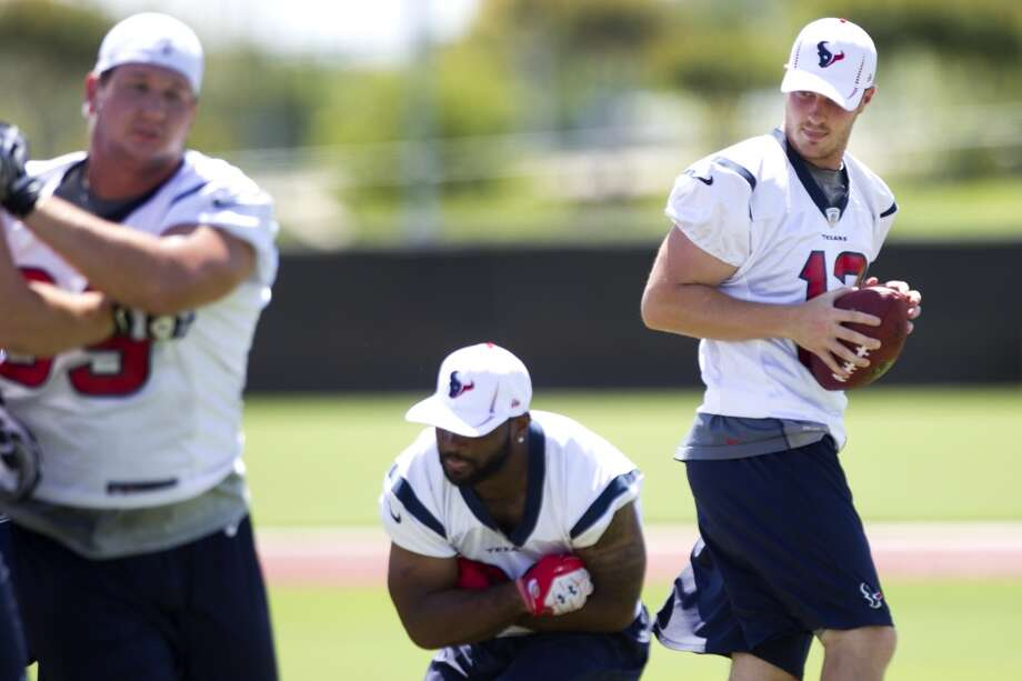Texans quarterback T.J. Yates drops back to pass after faking a handoff to running back Dennis Johnson.