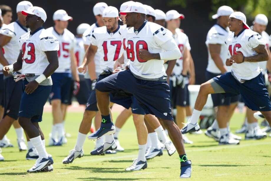 Texans wide receiver Andre Johnson (8) warms up at the beginning of practice.