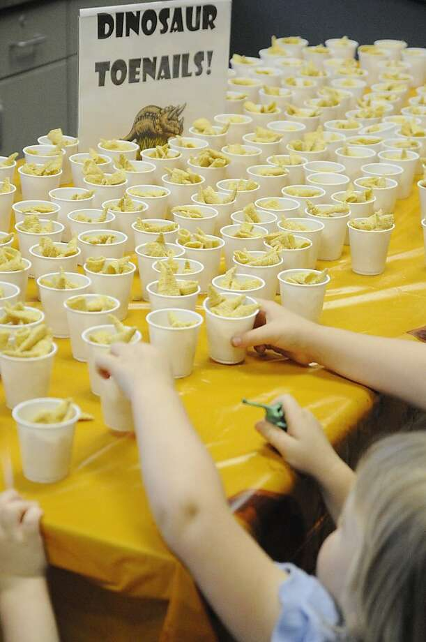 Fossil fuel: Prehistoric snacks are served for the kick-off of a summer reading program   in Sevierville, Tenn. (Note: Dinosaur toenails are better known as Bugles.) Photo: Curt Habraken, Associated Press