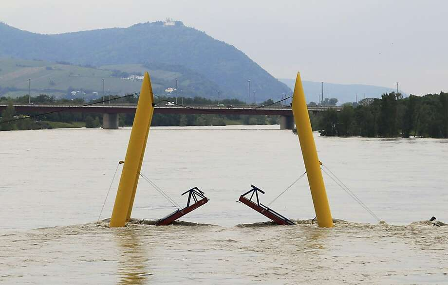 High water mark:A pedestrian bridge on the Danube River in Vienna is closed until further notice.   Austrian authorities warned that damage from Danube and Inn River flooding could match   or exceed $9.8 billion, the bill from the last major flooding in 2002. Photo: Alexander Klein, AFP/Getty Images