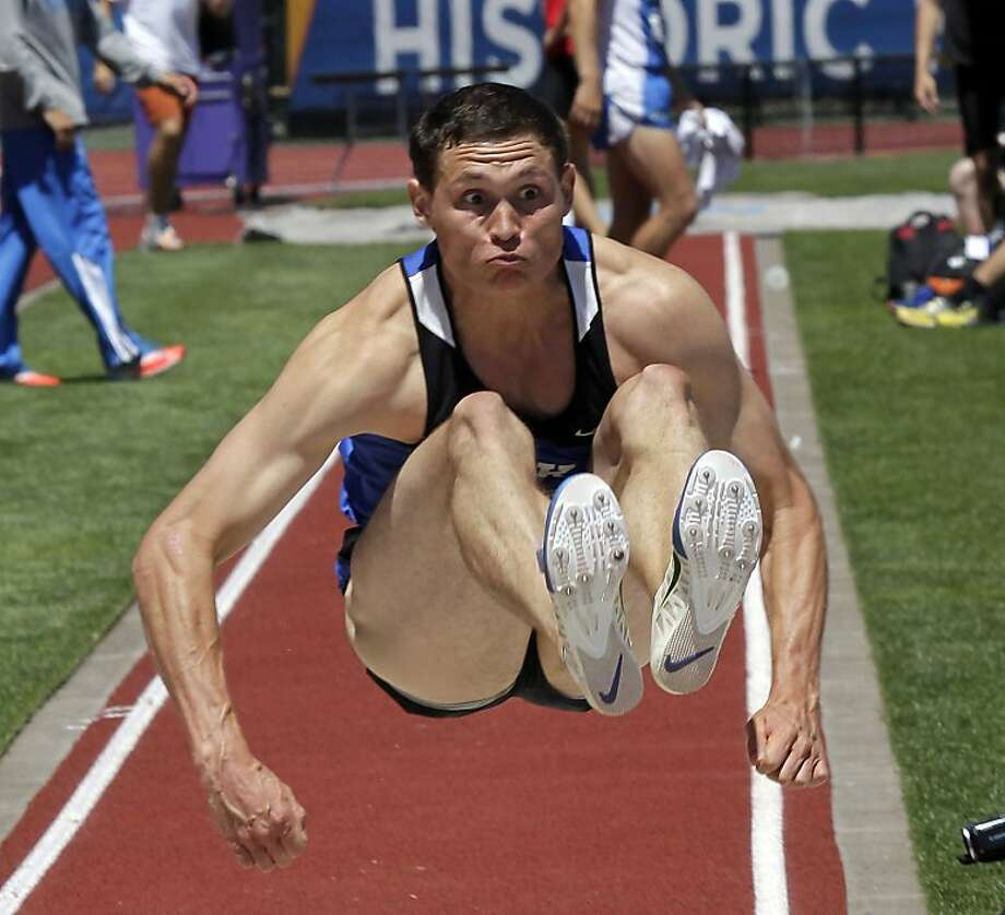 Bound for glory: Curtis Beach of Duke sets a new school record in the long jump portion of the decathlon, temporarily propelling him into second place in the event at the NCAA Track and Field Championships in Eugene, Ore. Photo: Don Ryan, Associated Press