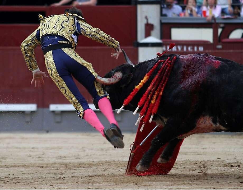 Hip pointer:Matador Juan Jose Padilla suffers a work-related injury during a bullfight in the Las Ventas bullring in Madrid. Photo: Alberto Simon, AFP/Getty Images