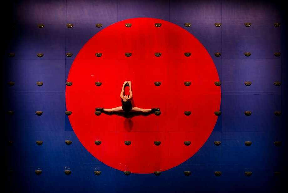 Ballet bull's-eye: A Deborah Colker Dance Company dancer performs an on-the-wall number 