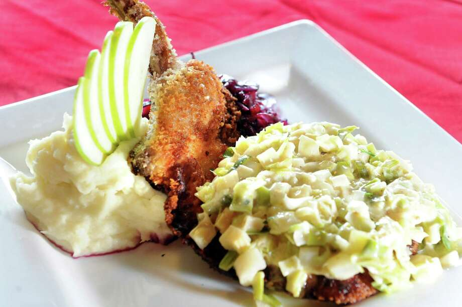The Merry Monk. 84 Henry St., Saratoga Springs.Pork Schnitzel with braised red cabbage, creamed leeks and mashed potatoes on Friday, May 31, 2013, at the Merry Monk in Saratoga Springs, N.Y. (Cindy Schultz / Times Union) Photo: Cindy Schultz / 00022635A