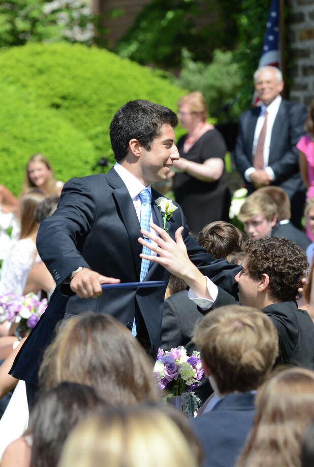 Munir Tariq Qaddourah, of Trumbull, embraces classmate Michael Shepard, of New Canaan, after receiving his diploma during the eighty-eighth commencement ceremony at Greens Farms Academy in Westport, Connecticut, on Thursday, June 6, 2013. Photo: Amy Mortensen / Connecticut Post Freelance
