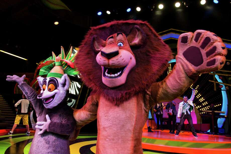 """This undated image supplied by Busch Gardens Tampa shows a performance from """"Madgascar Live!"""" which is a stage show at the theme park inspired by the animated """"Madgascar"""" movie. It's one of a number of new attractions this year at theme parks around the country. (AP Photo/ Busch Gardens Tampa)"""
