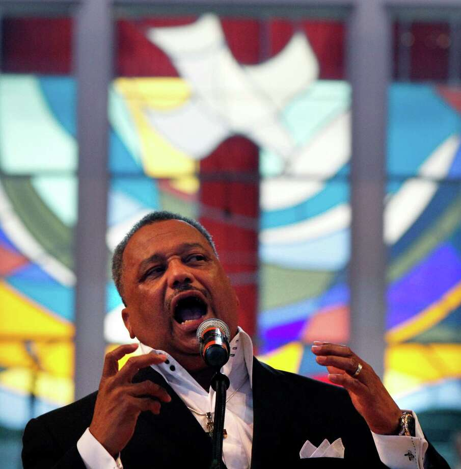 Rev. Fred Luter, pastor of the Franklin Ave. Baptist Church, delivers a sermon during Sunday Services at the Church in New Orleans, Sunday, June 3, 2012. The new face of a Christian denomination that formed on the wrong side of slavery before the Civil War could be an African-American preacher who grew up in New Orleans' Lower 9th Ward. The Southern Baptist Convention holds its annual meeting in New Orleans next week and it could see the election of Luter as president. Faced with growing diversity in America and declining membership in its churches, the denomination is making a sincere effort to distance itself from its troubled racial past. (AP Photo/Gerald Herbert) Photo: Gerald Herbert, STF / AP