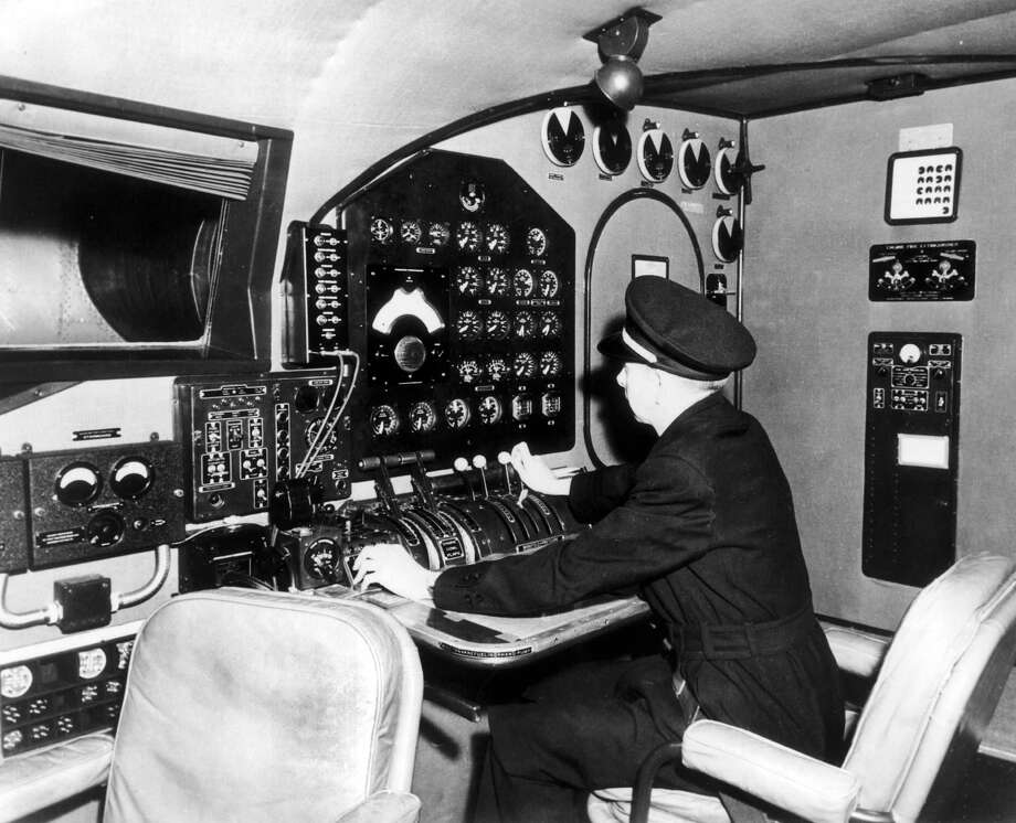 A flight engineer engineer is seated in the flight deck of the Pan Am Yankee Clipper in 1939. Photo: Gamma-Keystone Via Getty Images