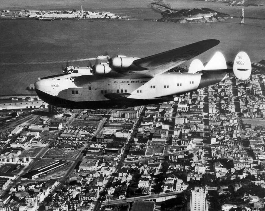 The Pan Am Yankee Clipper flies above San Fransisco, bound for Hong Kong. Photo: Gamma-Keystone Via Getty Images