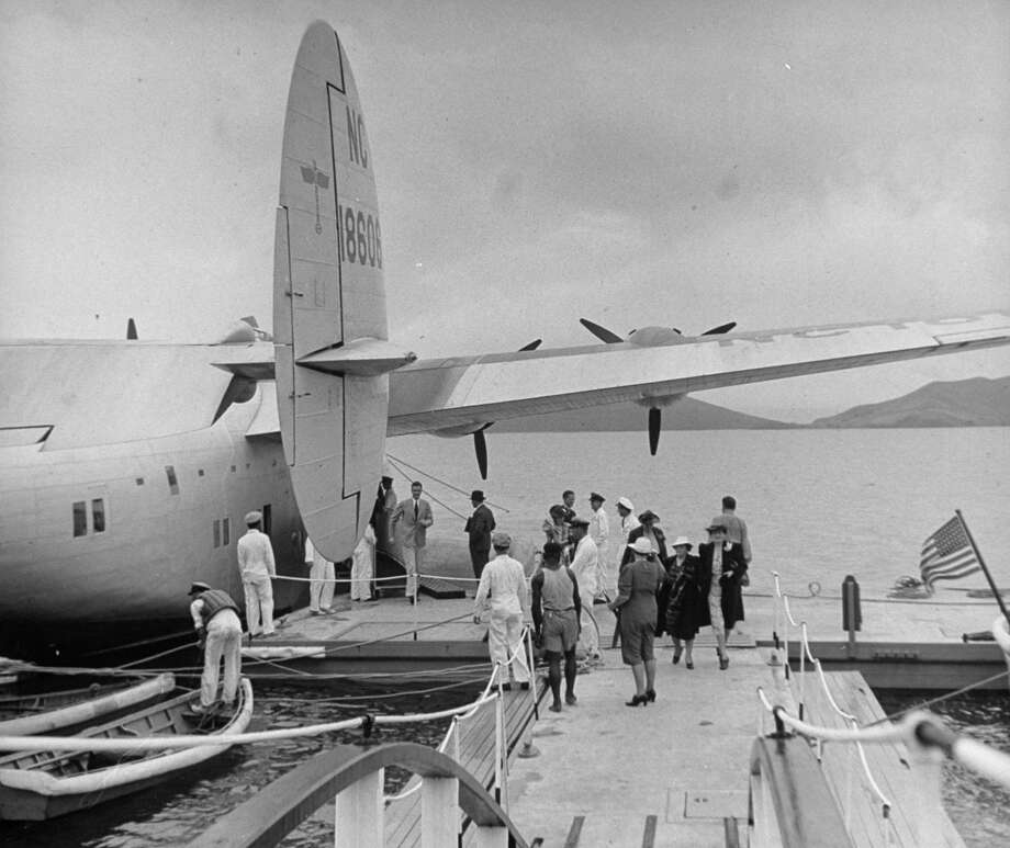 Here are passengers getting off after another Pan American Clipper landing. Photo: Wallace Kirkland, Time & Life Pictures/Getty Image / Time Life Pictures