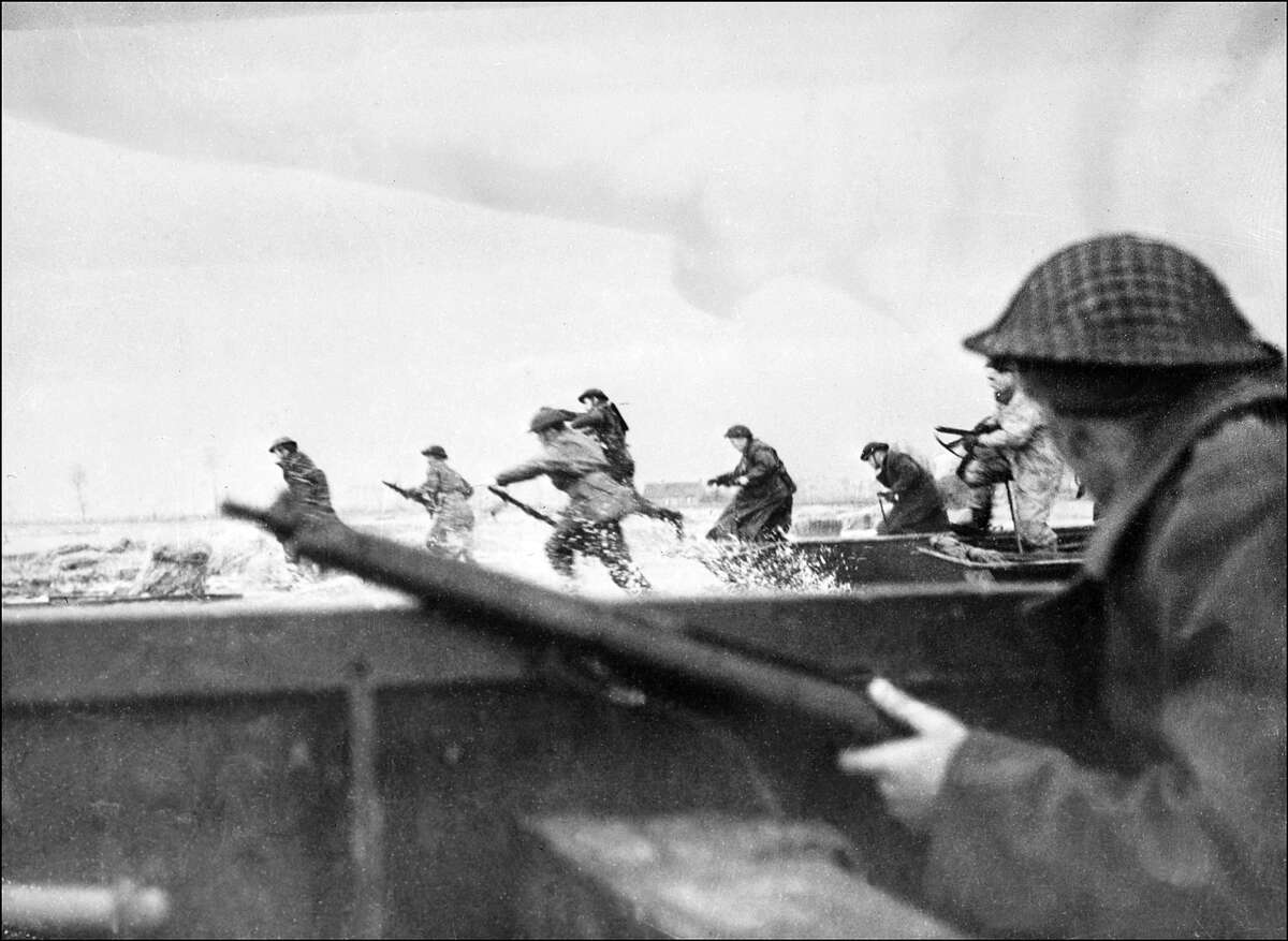 D-Day: Canadian soldiers land on Courseulles beach in Normandy as Allied forces storm the Normandy beaches on D-Day.