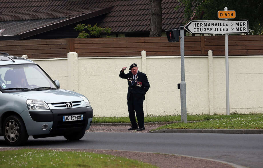 A Normandy veteran tries to cross the road as he attends a memorial service close to the British Sword beach at Colleville Montgomery on June 5, 2013 near Caen, France. Across Normandy several hundred of the surviving veterans of the Normandy campaign are gathering to commemorate the 69th anniversary of the D-Day landings which eventually led to the Allied liberation of France in 1944. Next year, which will mark the 70th anniversary of the landings, is widely expected to be the last time that the veterans will gather in any great number. Photo: Matt Cardy, Getty Images / 2013 Getty Images
