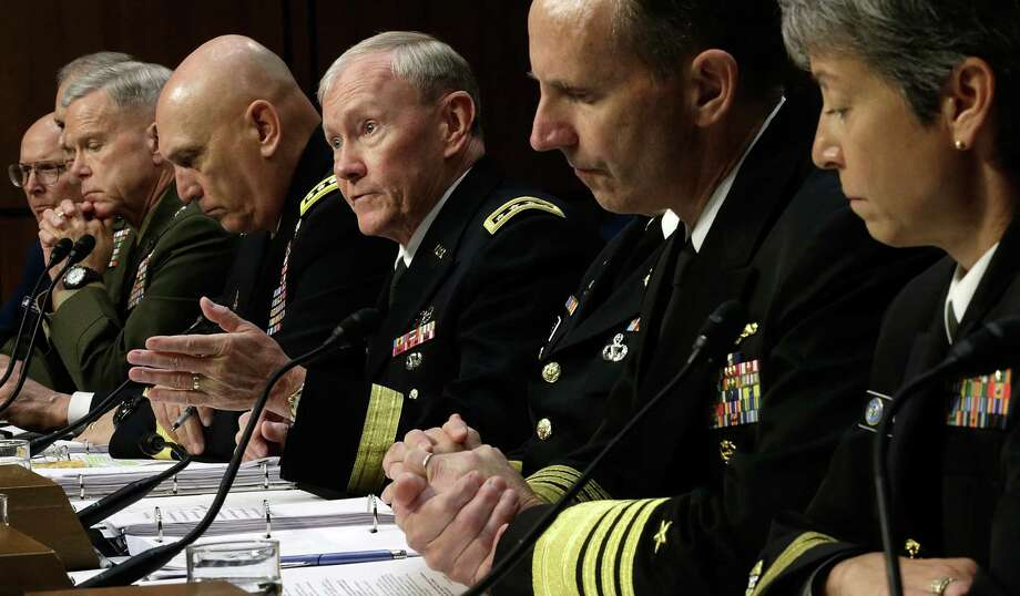 Chairman of the Joint Chiefs of Staff Gen. Martin Dempsey (third from the right) testifies with U.S. military leaders before the Senate Armed Services Committee on   legislation regarding sexual assaults in the military. Photo: Win McNamee, Getty Images