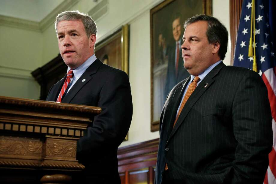 New Jersey Gov. Gov. Chris Christie, right, listens as New Jersey Attorney General Jeffrey Chiesa, 47, answers a question Thursday, June 6, 2013 in Trenton, N.J. Christie has named Chiesa to temporarily fill the U.S. Senate seat that opened up this week after Frank Lautenberg's death. Chiesa worked with Christie in the U.S. Attorney's office before becoming the top lawyer for the state government. He has overseen gun buyback programs all over the state, but has not had a particularly high profile. Christie has scheduled a special election for October to fill the seat until it expires in January 2015.(AP Photo/Mel Evans) Photo: Mel Evans, STF / AP