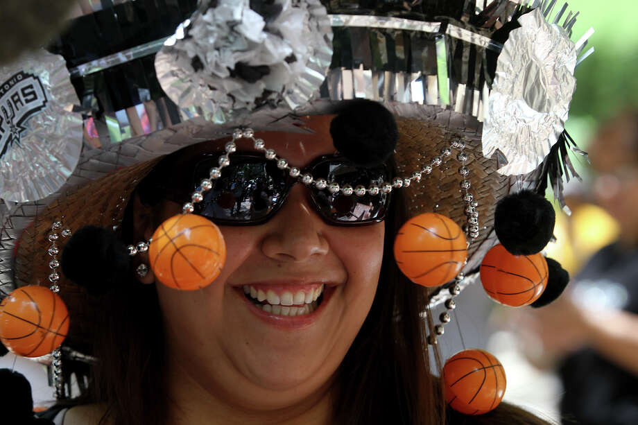 "Denise Cruz enjoys wearing her Spurs hat before boarding a barge Thursday June 6, 2013 during the ""Go Spurs Go!"" pep rally on the San Antonio River. The event was held in anticipation of game one of the NBA Finals featuring the San Antonio Spurs against the Miami Heat in Miami. Photo: JOHN DAVENPORT, SAN ANTONIO EXPRESS-NEWS / ©San Antonio Express-News/Photo may be sold to the public"