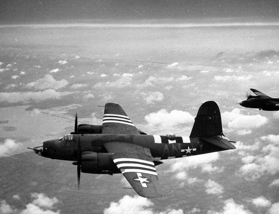 D-Day: B-26 Marauders with special D-Day markings heading towards the beaches of Cherbourg to lay smokescreen in advance of Allied Normandy beach landings during WWII. Photo: Frank Scherschel, Time & Life Pictures/Getty Image / Time Life Pictures
