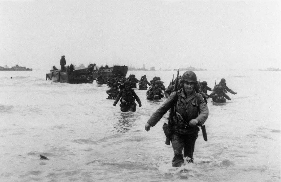 """D-Day: American troops of the 4th Infantry Division (""""Famous Fourth"""") land on Utah Beach 06 June 1944 while Allied forces storm the Normandy beaches on D-Day. Photo: STF, AFP/Getty Images / 2010 AFP"""