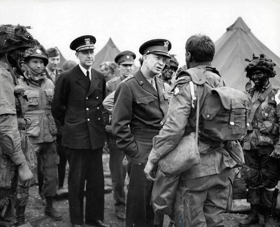 "D-Day: General Dwight D, Eisenhower gives the order of the day ""Full victory, Nothing Else"" to paratroopers before they board their airplanes to participate in the first assault in the Allied invasion of France. Photo: Popperfoto, Popperfoto/Getty Images / Popperfoto"