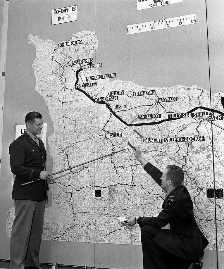 15th June, 1944:Press Correspondents are briefed by officers with maps showing advances into France. Photo: Popperfoto, Popperfoto/Getty Images / Popperfoto