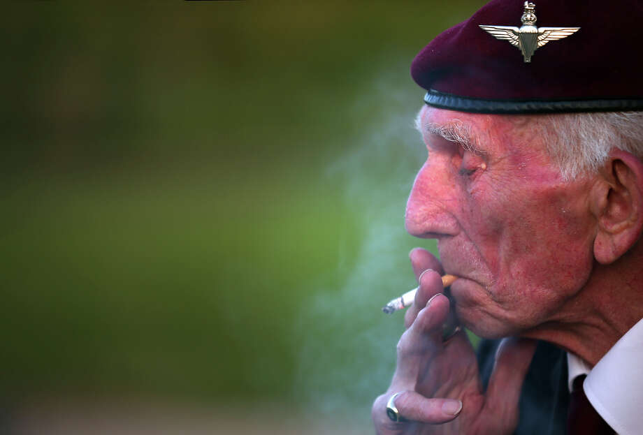 Normandy veteran Douglas Baines, 89, (who was a paratrooper dropped into Normandy in the early hours of D-Day) smokes a cigarette as he visits the Pegasus Bridge Memorial Museum on June 5, 2013 near Caen, France. Across Normandy several hundred of the surviving veterans of the Normandy campaign are gathering to commemorate the 69th anniversary of the D-Day landings which eventually led to the Allied liberation of France in 1944. Next year, which will mark the 70th anniversary of the landings, is widely expected to be the last time that the veterans will gather in any great number. Photo: Matt Cardy, Getty Images / 2013 Getty Images