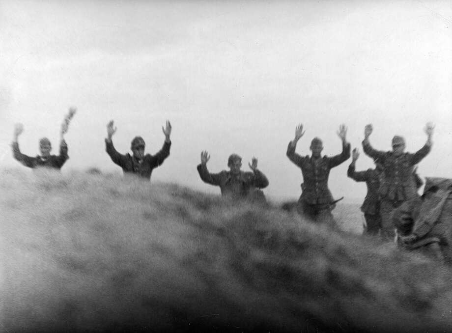 D-Day Plus Three: German soldiers walk with raised arms as they surrender shortly after the Allied D-Day invasion, Quinville, France. Photo: Time Life Pictures, Time & Life Pictures/Getty Image / Time Life Pictures