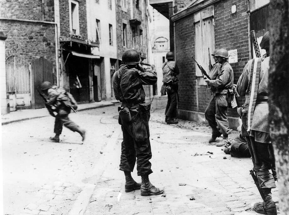 9th August, 1944: American infantrymen take aim at sniper positions during the house-to-house fighting in Saint-Malo, two months after the allied troops landed on Normandy beaches (north-west of France), to come as reinforcements during the historic D-Day landings. Photo: STF, AFP/Getty Images / AFP
