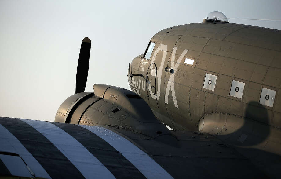 The afternoon sunlight illuminates a Second World War Dakota aircraft displayed at the Merville Gun Battery on June 5, 2013 near Caen, France. Across Normandy several hundred of the surviving veterans of the Normandy campaign are gathering to commemorate the 69th anniversary of the D-Day landings which eventually led to the Allied liberation of France in 1944. Next year, which will mark the 70th anniversary of the landings, is widely expected to be the last time that the veterans will gather in any great number. Photo: Matt Cardy, Getty Images / 2013 Getty Images