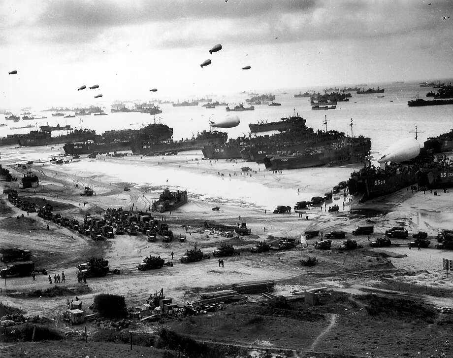 D-Day Plus One: Massive landing and deployment of US troops, supplies and equipment day after victorious D-Day action on Omaha Beach, barrage balloons keep watch overhead for German aircraft while scores of ships unload men & materials. Photo: Time Life Pictures, Time & Life Pictures/Getty Image / Time Life Pictures