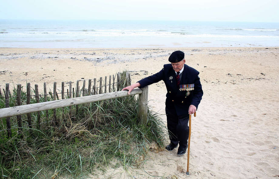 Normandy veteran Major Edwin Hunt walks up from what was the British Sword beach at Colleville Montgomery on June 5, 2013 near Caen, France. Across Normandy several hundred of the surviving veterans of the Normandy campaign are gathering to commemorate the 69th anniversary of the D-Day landings which eventually led to the Allied liberation of France in 1944. Next year, which will mark the 70th anniversary of the landings, is widely expected to be the last time that the veterans will gather in any great number. Photo: Matt Cardy, Getty Images / 2013 Getty Images