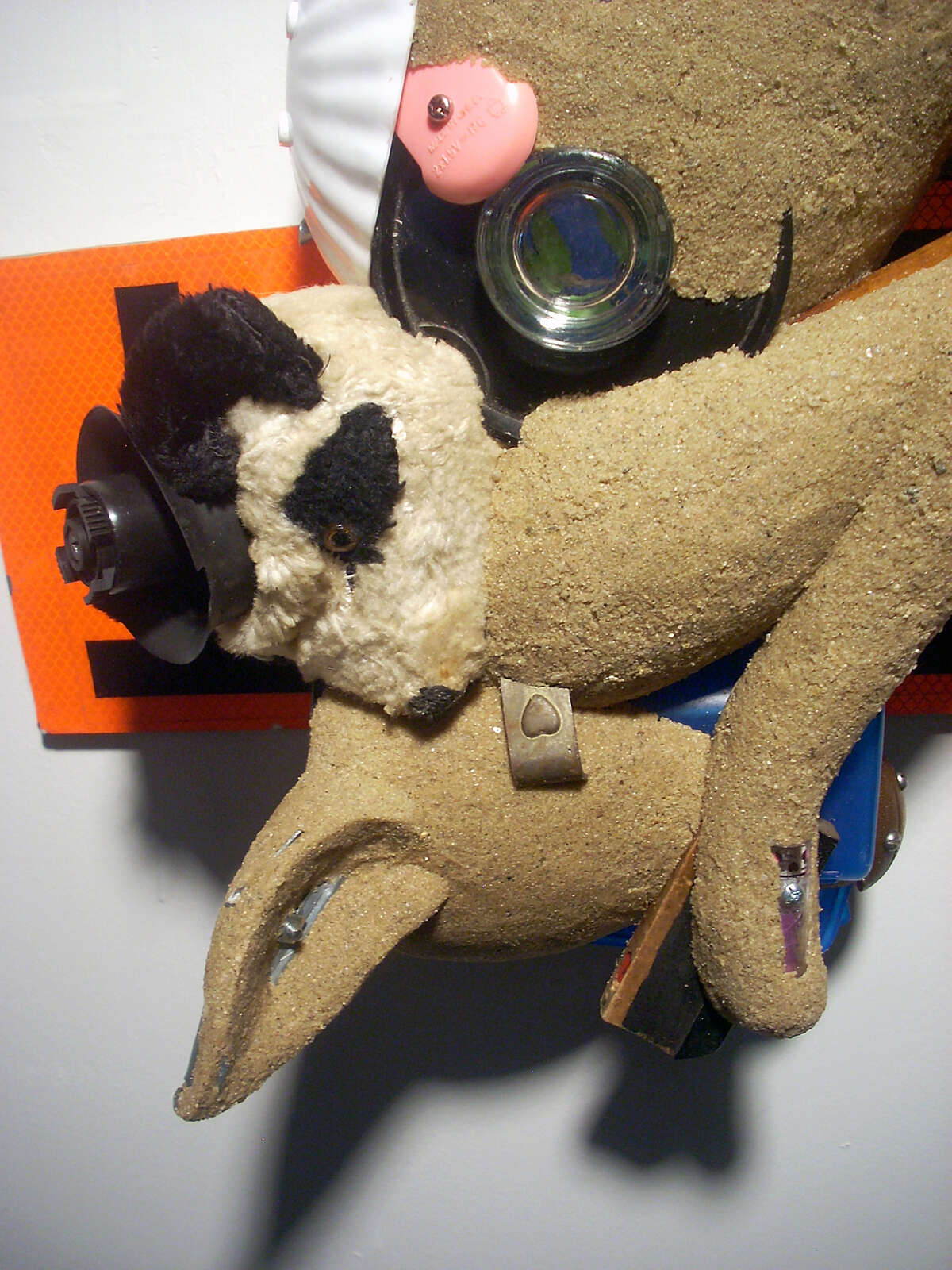 """D. Dominick Lombardi's """"dog piece"""" (detail) is about a night's sleep ruined by information overload. It's on view at Housatonic Museum of Art in Bridgeport."""