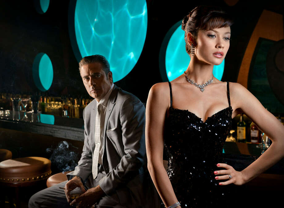 More drama engulfs Miami Beach hotelier Ike Evans (Jeffrey Dean Morgan) and his beautiful wife, Vera (Olga Kurylenko), in season two of Magic City.' Photo: Starz