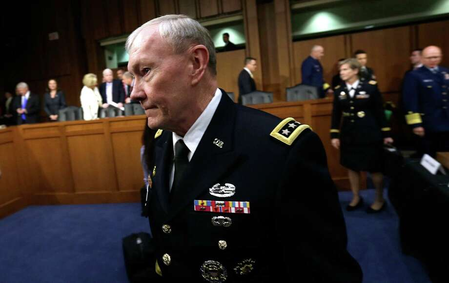 Chairman of the Joint Chiefs of Staff Gen. Martin Dempsey arrives for testimony with U.S. military leaders before the Senate Armed Services Committee on pending legislation regarding sexual assaults in the military. Photo: Win McNamee, Getty Images / 2013 Getty Images