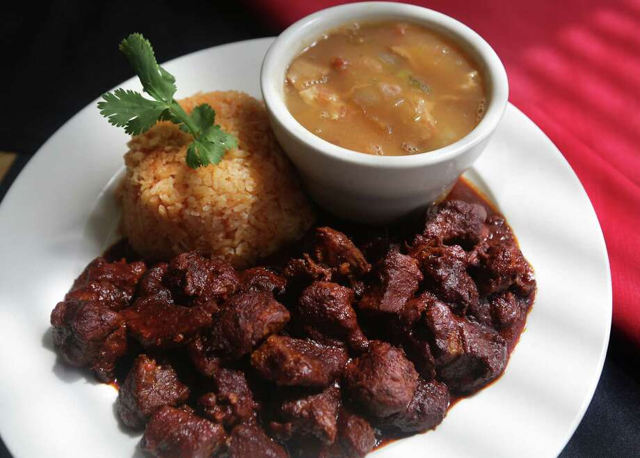 The carne de puerco en chile cascabel, one of Café Salsita's especiales, has slow-simmered pork chunks blended with thick and slightly spicy sauce. Photo: Bob Owen / San Antonio Express-News