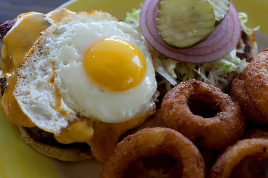 This cheeseburger with bacon and egg is an example of the variety of burgers served at Charlie Brown's Neighborhood Bar & Grill. Photo: John Davenport / San Antonio Express-News