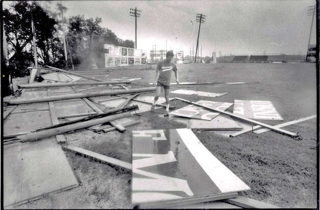 Head grounds keeper, David Perkins, surveys the damage at Vincent-Beck Stadium.  File Photo of The Beaumont Enterprise