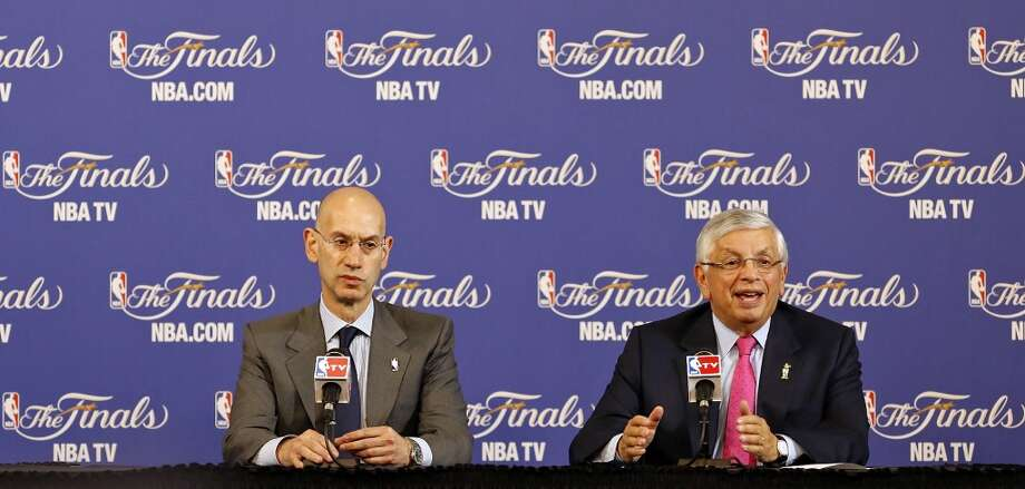 NBA Deputy Commissioner Adam Silver (left) and NBA Commissioner David Stern speak before Game 1 of the 2013 NBA Finals between the San Antonio Spurs and the Miami Heat Thursday June 6, 2013 at American Airlines Arena in Miami, Fla.