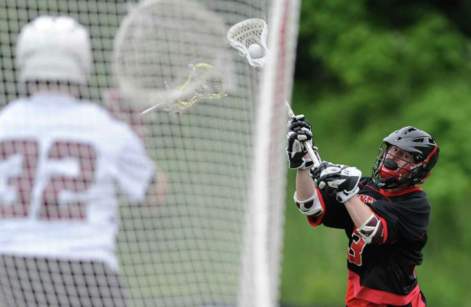 Pomperaug's Dylan McAllister shoots during Bethel's 17-9 win over Pomperaug in the SWC Dvision 2 boys lacrosse championship game at Immaculate High School in Danbury, Conn. on Thursday, June 6, 2013. Photo: Tyler Sizemore / The News-Times