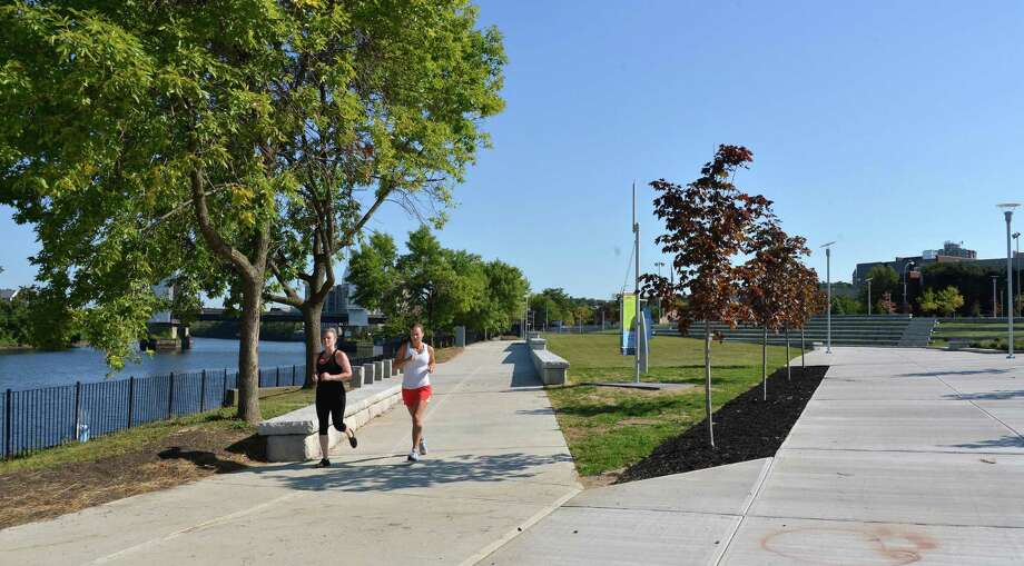 Joggers run through Troy's Riverfront Park Wednesday Sept. 12, 2012.  (John Carl D'Annibale / Times Union) Photo: John Carl D'Annibale / 00019232A