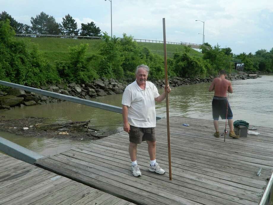 Rensselaer County Legislator Mike Stammel wants new signs to alert people that some areas along the Hudson River are deep, with fast-moving currents. He shows an 8-foot measuring stick that did not touch the bottom of the river from a fishing dock in Rensselaer. (Provided photo)