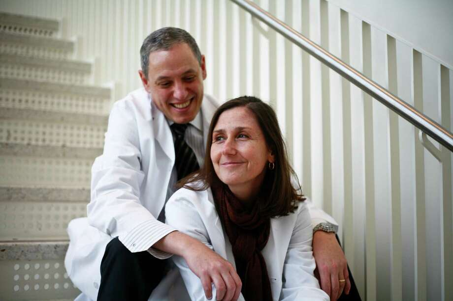 "Dr. Wadih Arap and his wife, Dr. Renata Pasqualini, share a lab at MD Anderson Cancer Center. Arap's courtship lasted only two days before she agreed to marry him. ""He definitely was the one chasing me,"" she said. Photo: Michael Paulsen, Staff / Houston Chronicle"