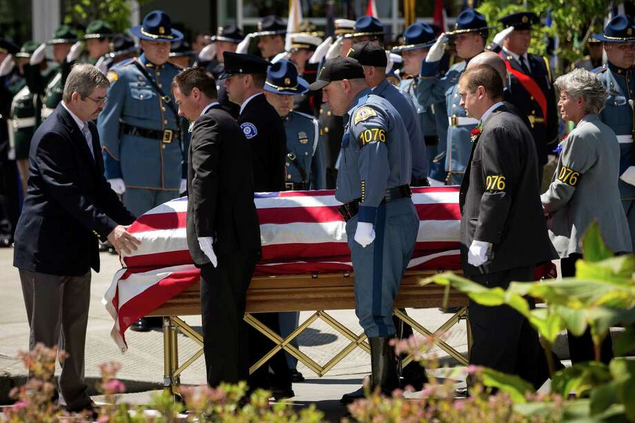 The casket of the late Washington State Patrol Trooper Sean M. O'Connell Jr. gets unloaded during a memorial service Thursday, June 6, 2013, at the Comcast Arena in Everett. Following a 13-mile vehicular procession, thousands of friends, family and law enforcement attended the ceremony. O'Connell was killed in a collision with a truck while working Conway. Photo: JORDAN STEAD, SEATTLEPI.COM / SEATTLEPI.COM